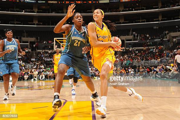Candace Parker of the Los Angeles Sparks goes hard to the basket against the defense of Nicky Anosike of the Minnesota Lynx at Staples Center on...
