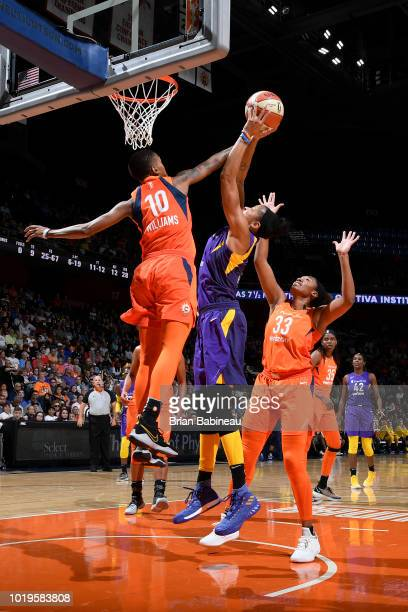 Candace Parker of the Los Angeles Sparks goes to the basket against Courtney Williams of the Connecticut Sun on August 19 2018 at the Mohegan Sun...