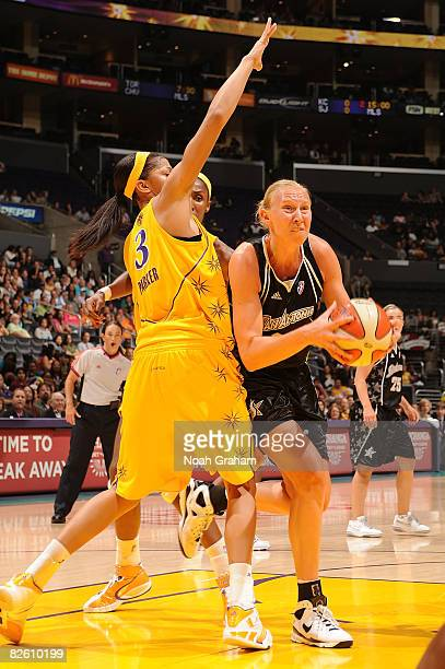 Candace Parker of the Los Angeles Sparks guards as Ann Wauters of the San Antonio Stars drives to the basket during the game at Staples Center on...
