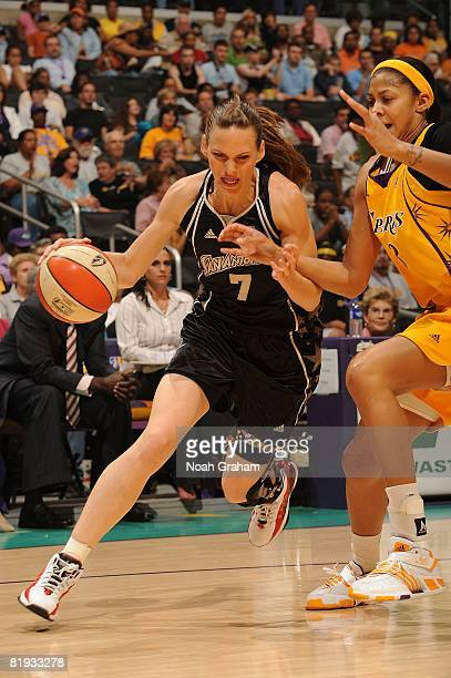 Candace Parker of the Los Angeles Sparks guards as Erin Buescher of the San Antonio Silver Stars drives the ball during the game at Staples Center...