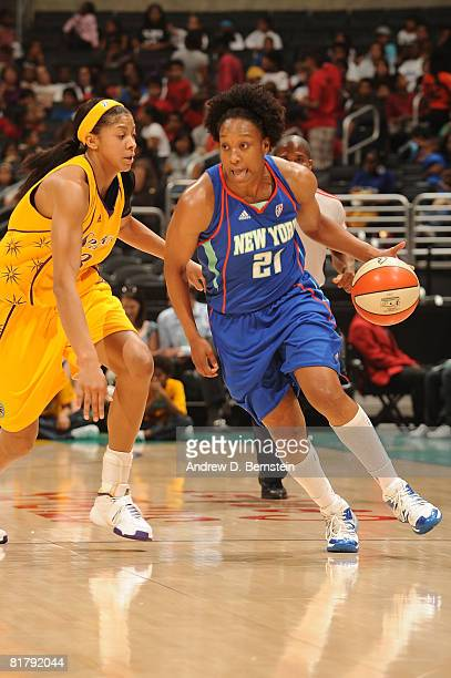 Candace Parker of the Los Angeles Sparks guards Loree Moore of the New York Liberty on July 1 2008 at Staples Center in Los Angeles California NOTE...