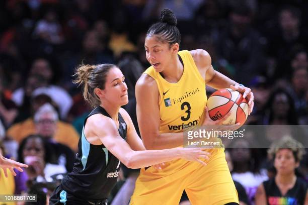 Candace Parker of the Los Angeles Sparks handles the ball against Rebecca Allen of the New York Liberty during a WNBA basketball game at Staples...