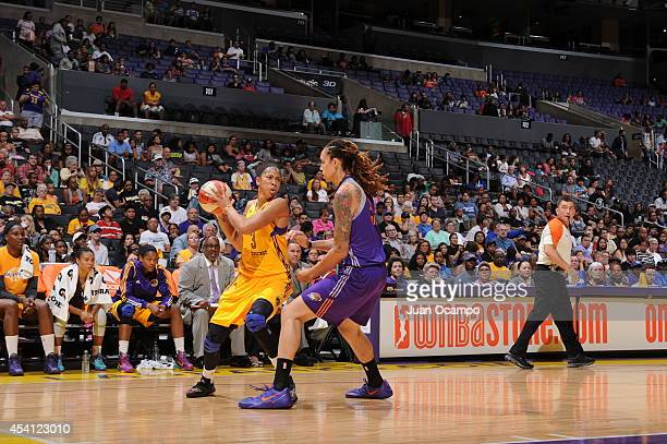Candace Parker of the Los Angeles Sparks handles the ball against Brittney Griner of the Phoenix Mercury in Game Two of the Western Conference...
