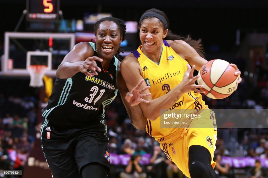 Candace Parker #3 of the Los Angeles Sparks handles the ball against Tina Charles #31 of the New York Liberty during a WNBA basketball game at Staples Center on August 4, 2017 in Los Angeles, California.