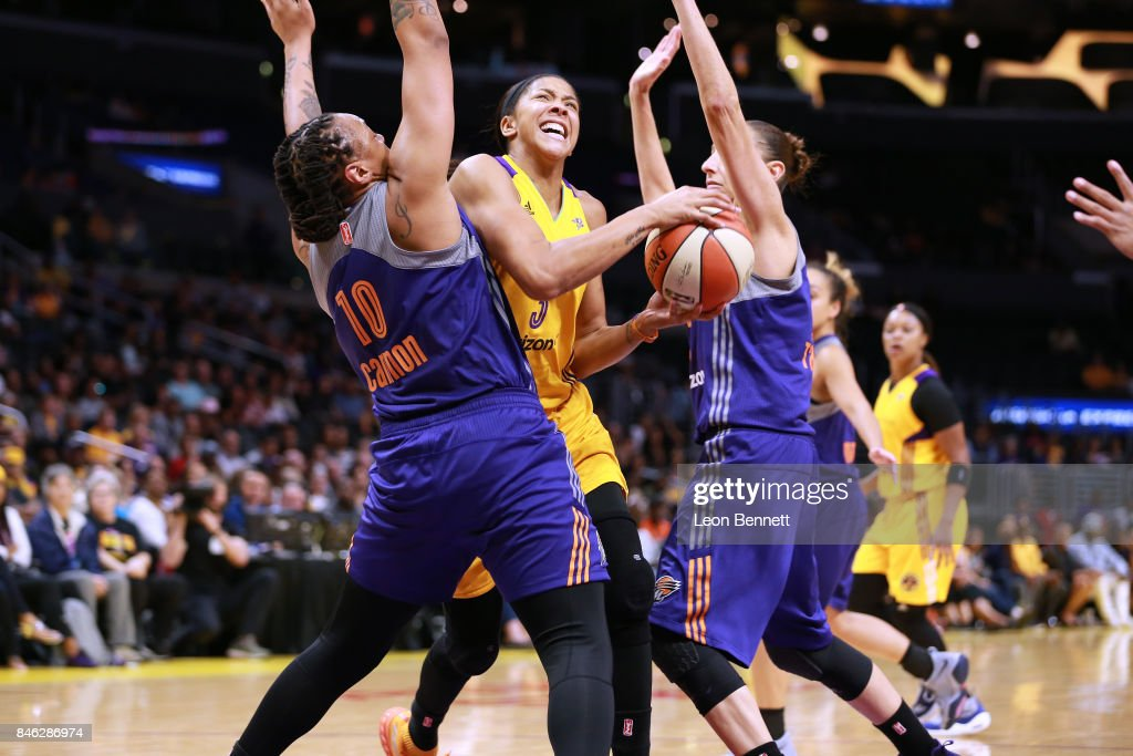 Candace Parker #3 of the Los Angeles Sparks handles the ball against Emma Cannon #10 and Diana Taurasi #3 of the Phoenix Mercury during a WNBA Playoff Game at Staples Center on September 12, 2017 in Los Angeles, California.