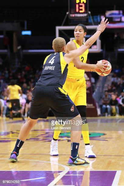 Candace Parker of the Los Angeles Sparks handles the ball against Candice Dupree of the Indiana Fever during a WNBA basketball game at Staples Center...