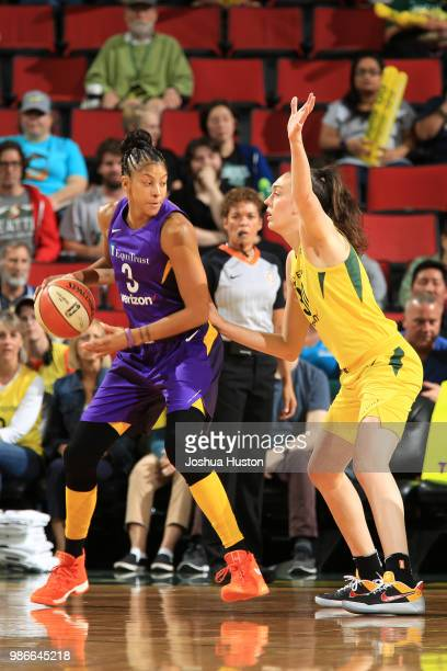 Candace Parker of the Los Angeles Sparks handles the ball against Breanna Stewart of the Seattle Storm on June 28 2018 at Key Arena in Seattle...
