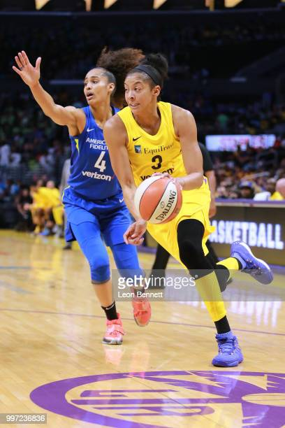Candace Parker of the Los Angeles Sparks handles the ball against Skylar DigginsSmith of the Dallas Wings during a WNBA basketball game at Staples...