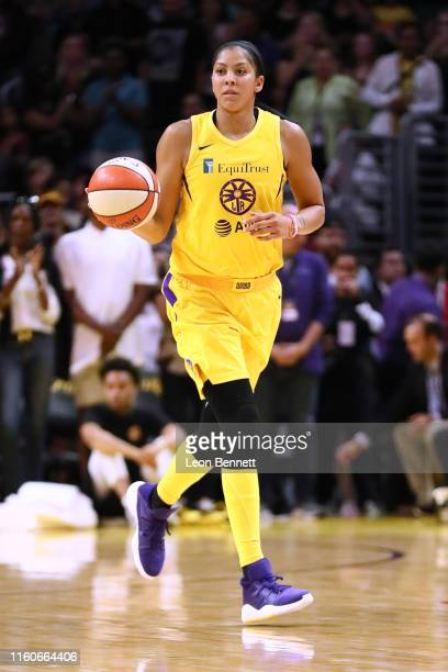 Candace Parker of the Los Angeles Sparks handles the ball against the Washington Mystics during a WNBA basketball game at Staples Center on July 07...
