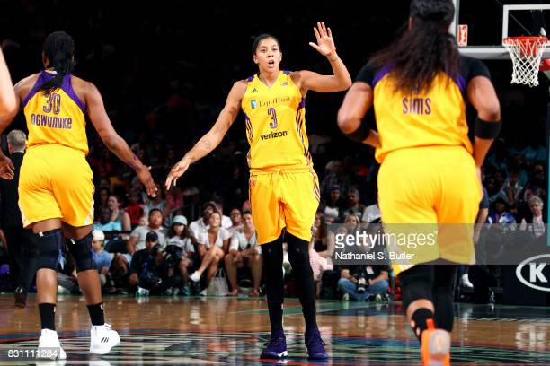 Candace Parker of the Los Angeles Sparks high fives her teammates during the game against the New York Liberty during a WNBA game at Madison Square...