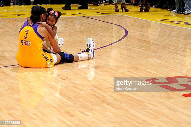 Candace Parker of the Los Angeles Sparks hugs her daughter Lailla Williams on the court after the game against the Tulsa Shock at Staples Center on...