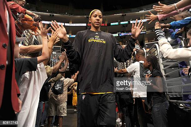 Candace Parker of the Los Angeles Sparks is greeted by fans as she takes the court before the game against the Seattle Storm on September 14, 2008 at...