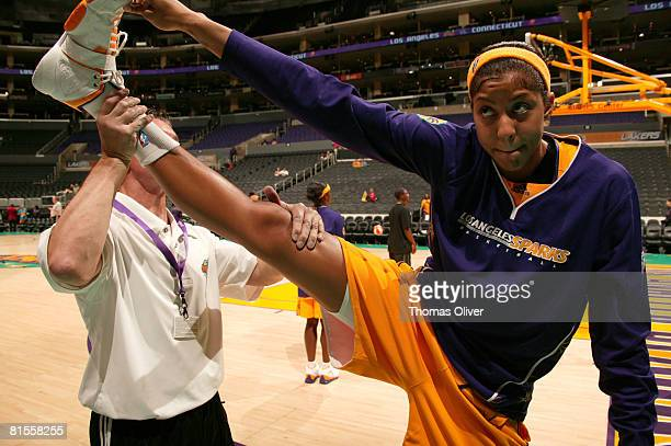 Candace Parker of the Los Angeles Sparks is stretched out by a trainer before the game against the Connecticut Sun at Staples Center on June 13 2008...