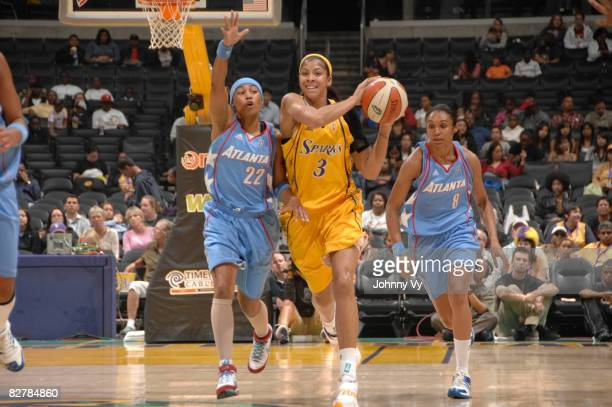 Candace Parker of the Los Angeles Sparks makes a pass against the defense of Betty Lennox of the Atlanta Dream on September 11, 2008 at Staples...