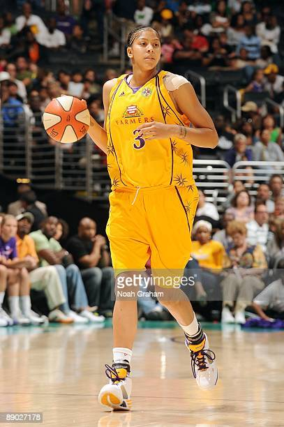 Candace Parker of the Los Angeles Sparks moves the ball up court during the game against the Phoenix Mercury at Staples Center on July 5 2009 in Los...