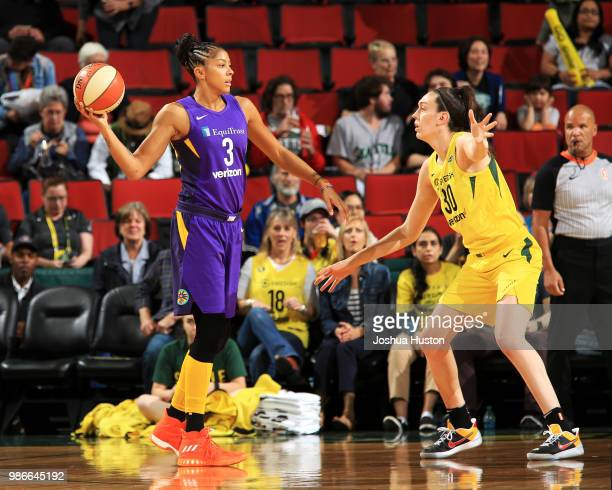 Candace Parker of the Los Angeles Sparks passes the ball against the Seattle Storm on June 28 2018 at Key Arena in Seattle Washington NOTE TO USER...