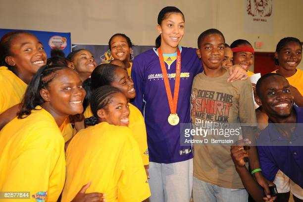 Candace Parker of the Los Angeles Sparks poses for a photo with participant at the Project Rebound clinic on August 27 2008 at Morningside High...