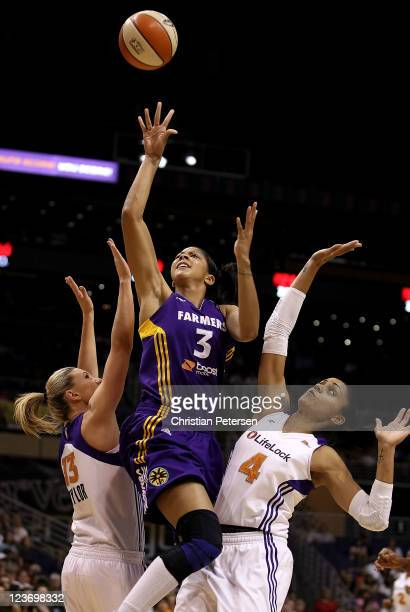 Candace Parker of the Los Angeles Sparks puts up a shot between Penny Taylor and Candice Dupree of the Phoenix Mercury during the WNBA game at US...