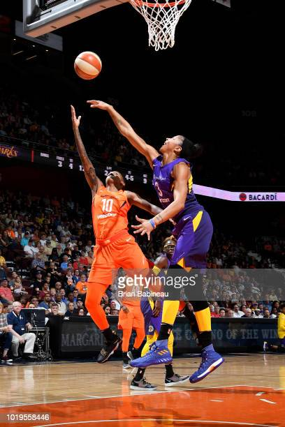 Candace Parker of the Los Angeles Sparks reaches for the rebound against Courtney Williams of the Connecticut Sun on August 19 2018 at the Mohegan...