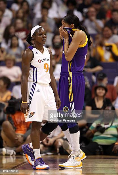 Candace Parker of the Los Angeles Sparks reacts near Marie FerdinandHarris of the Phoenix Mercury during the WNBA game at US Airways Center on...