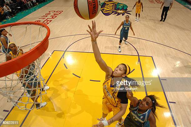 Candace Parker of the Los Angeles Sparks shoots against Candice Wiggins of the Minnesota Lynx at Staples Center on September 1 2008 in Los Angeles...