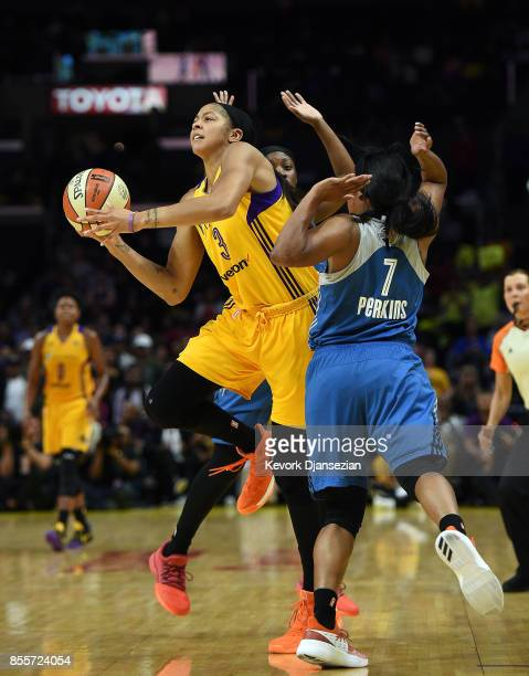 Candace Parker of the Los Angeles Sparks shoots in between Alexis Jones of the Minnesota Lynx and Jia Perkins of the Minnesota Lynx during the first...