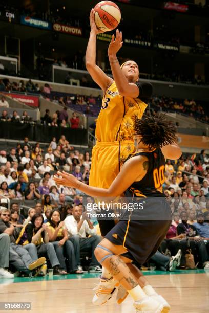 Candace Parker of the Los Angeles Sparks shoots over Tamika Whitmore of the Connecticut Sun at Staples Center on June 13 2008 in Los Angeles...