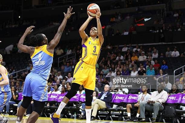 Candace Parker of the Los Angeles Sparks shoots the ball over Clarissa Dos Santos of the Chicago Sky in a WNBA game at Staples Center on August 16...