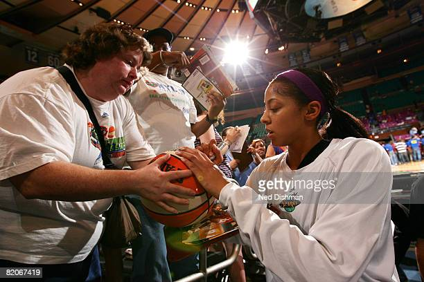 Candace Parker of the Los Angeles Sparks signs autographs before game against the New York Liberty on July 25 2008 at Madison Square Garden in New...