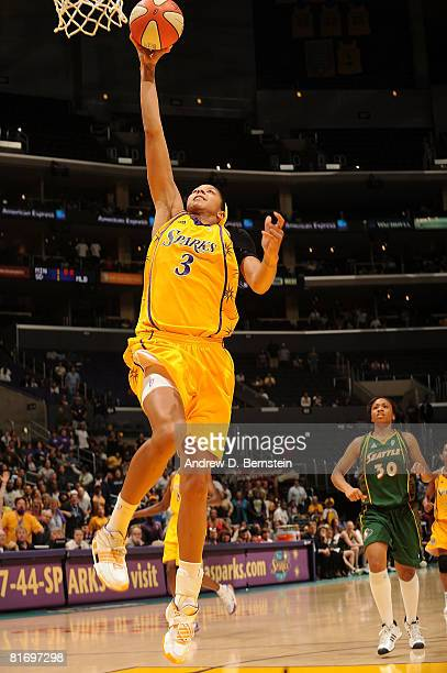 Candace Parker of the Los Angeles Sparks slam dunks during the game against the Seattle Storm on June 24 2008 at Staples Center in Los Angeles...