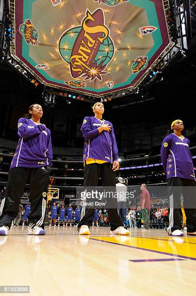 Candace Parker of the Los Angeles Sparks stands during the National Anthem before taking on the Detroit Shock at Staples Center on June 11 2008 in...