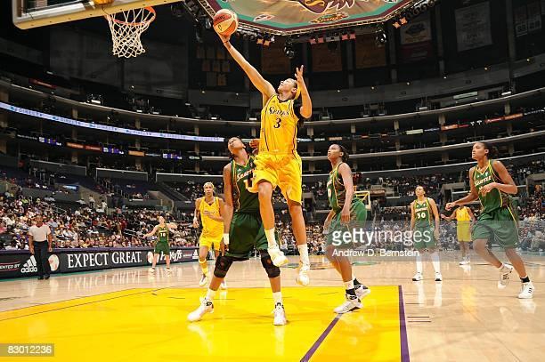 Candace Parker of the Los Angeles Sparks takes the ball to the basket against the Seattle Storm during Game One of the Western Conference Semifinals...