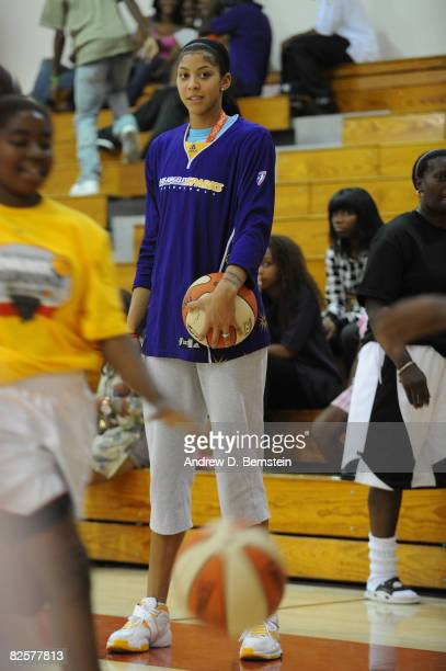Candace Parker of the Los Angeles Sparks watches as participants take part in the basketball handling drills at the Project Rebound clinic on August...