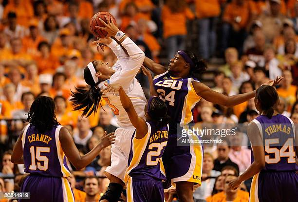 Candace Parker of the Tennessee Lady Volunteers attempts a shot in the second half against Sylvia Fowles Allison Hightower Quianna Chaney and Ashley...