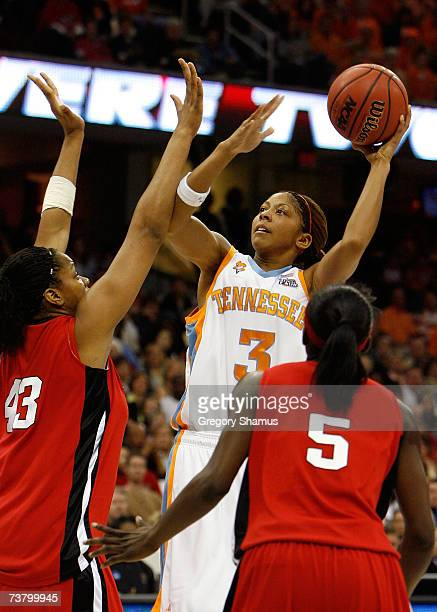 Candace Parker of the Tennessee Lady Volunteers attempts a shot against Rashidat Junaid and Essence Carson of the Rutgers Scarlet Knights during the...