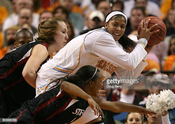 Candace Parker of the Tennessee Lady Volunteers looks to pass the ball against Kayla Pedersen and Candice Wiggins of the Stanford Cardinal during the...