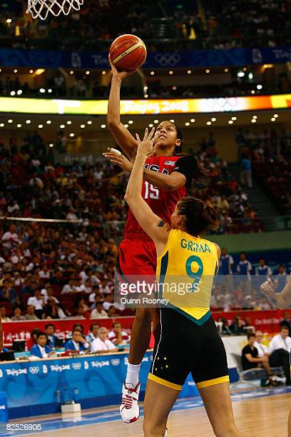 Candace Parker of the United States goes up for a shot attempt against Hollie Grima of Australia during the women's basketball gold medal game at the...