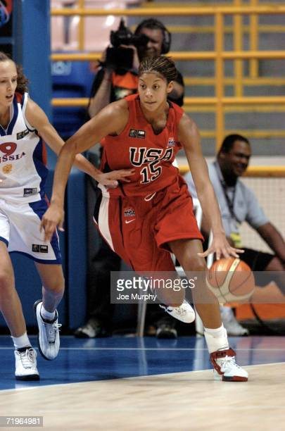 Candace Parker of the U.S. Drives past Tatiana Shchergoleva of Russia during a semi-final game at the 2006 FIBA World Championship For Women at...