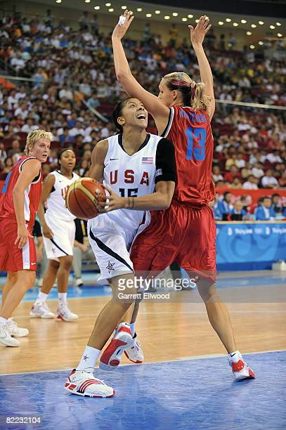 Candace Parker of the U.S. Women's Senior National Team looks to shoot against Petra Kulichova of the Czech Republic during day one of basketball at...