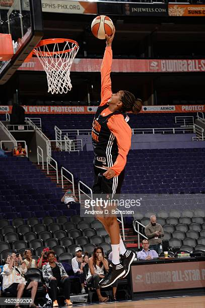 Candace Parker of the Western Conference AllStars attempts a dunk during AllStar Practice and Media Availability on July 18 2014 at US Airways Center...