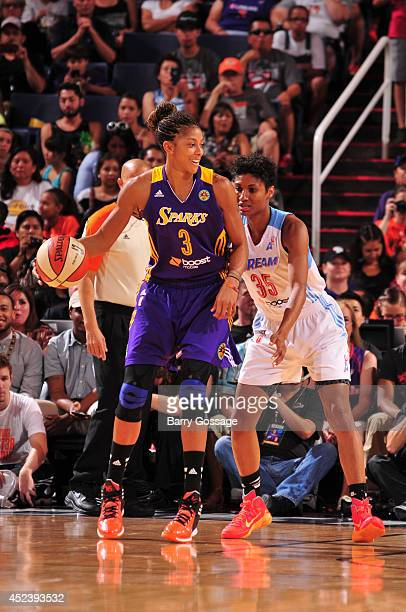 Candace Parker of the Western Conference AllStars posts up against Angel McCoughtry o fthe Eastern Conference AllStars during the 2014 Boost Mobile...