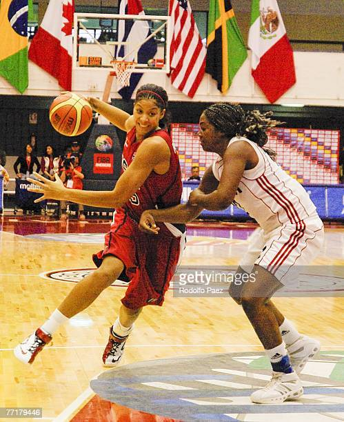 Candace Parker of USA tries to avoid Clenia Noblet Salazar of Cuba during the women's FIBA Americas Championship at the Arena on September 30 2007 in...