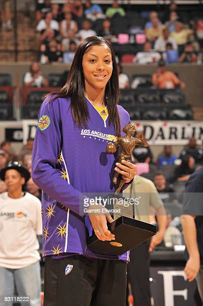 Candace Parker poses for a photo with the 2008 WNBA Most Valuable Player award presented by T-Mobile prior to Game Two of the WNBA Finals on October...