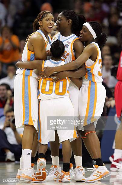 Candace Parker Shannon Bobbitt Nicky Anosike and Alberta Auguste of the Tennessee Lady Volunteers react after Anosike scored a 2point basket against...