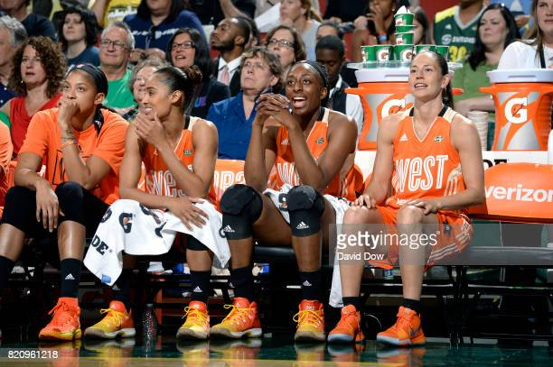 Candace Parker Skylar DigginsSmith Nneka Ogwumike and Sue Bird of the Western Conference All Stars cheer during the game against the Eastern...