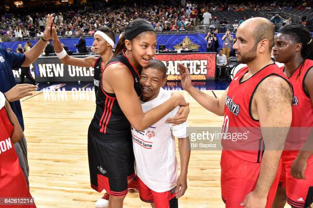 Candance Parker of the West Team hugs Muggsy Bogues of the East Team after the NBA Cares Special Olympics Unified Sports Game as part of 2017 AllStar...