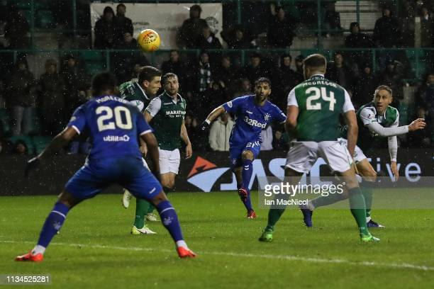 Candeias of Rangers opens the scoring during the Ladbrokes Premiership match between Hibernian and Rangers at Easter Road on March 08 2019 in...