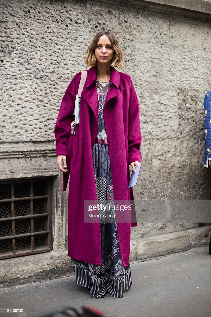 Candela Novembre attends the Fay show in a Blumarine coat, Alberta Ferretti dress, Jimmy Choo shoes, and Sara Battaglia bag on February 25, 2015 in Milan, Italy.