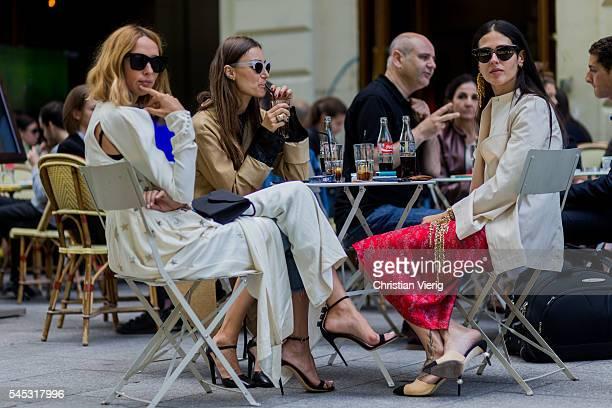 Candela Novembre Giorgia Tordini and Gilda Ambrosio sitting ina cafe in Paris drinking Coca Cola outside Viktor Rolf during Paris Fashion Week Haute...