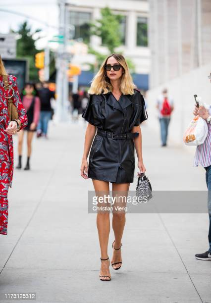 Candela Novembre is seen wearing black zipped dress outside Longchamp during New York Fashion Week September 2019 on September 07, 2019 in New York...